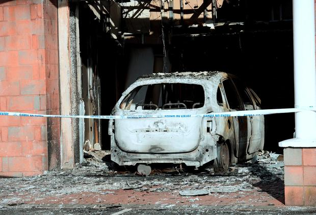 Burnt-out car and fire damage at entrance of Flyefit gym. Coolock retail park, Malahide Road, Dublin. Picture: Caroline Quinn