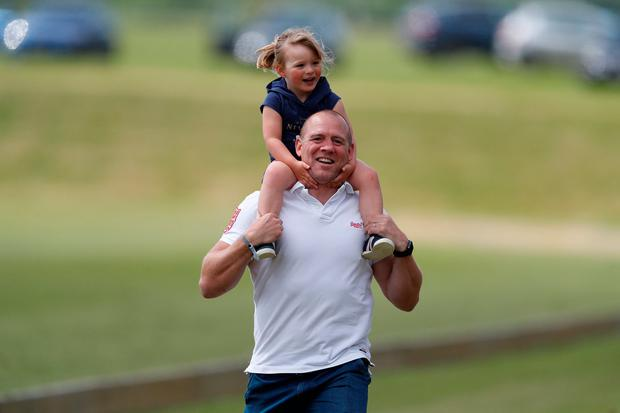 Mike Tindall carries his daughter Mia Tindall on his shoulders at the Maserati Royal Charity Polo Trophy at Beaufort Polo Club in Tetbury, Britain, June 11, 2017. REUTERS/Peter Nicholls