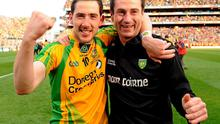 Donegal player Mark McHugh, left, and assistant manager Rory Gallagher celebrate after the final whistle in 2013