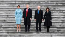 Newly inaugurated U.S. President Donald Trump (in red tie), first lady Melania (L), Vice President Mike Pence and his wife Karen (R) watch as the Executive One helicopter departs carrying outgoing President Barack Obama and outgoing first lady Michelle Obama during Trump's swearing ceremony in Washington, U.S., January 20, 2017.   REUTERS/Mike Segar