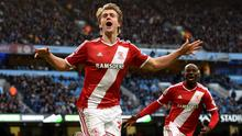 Middlesbrough's Patrick Bamford celebrates scoring his sides first goal of the game during the FA Cup Fourth Round match at the Etihad Stadium, Manchester. PRESS ASSOCIATION Photo. Picture date: Saturday January 24, 2015. See PA story SOCCER Man City. Photo credit should read: Martin Rickett/PA Wire. RESTRICTIONS: Editorial use only. Maximum 45 images during a match. No video emulation or promotion as 'live'. No use in games, competitions, merchandise, betting or single club/player services. No use with unofficial audio, video, data, fixtures or club/league logos.