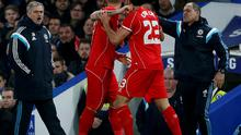 Chelsea's manager Jose Mourinho (L) argues with Liverpool's Emre Can (R) and Martin Skrtel during their English League Cup semi-final second leg soccer match at Stamford Bridge