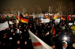 "Participants take part in a demonstration called by anti-immigration group PEGIDA, a German abbreviation for ""Patriotic Europeans against the Islamization of the West"", in Dresden January 5, 2015. Several thousand opponents of Germany's policy towards asylum seekers and Islam are expected to attend the protest in the eastern German town on Monday.       REUTERS/Fabrizio Bensch"