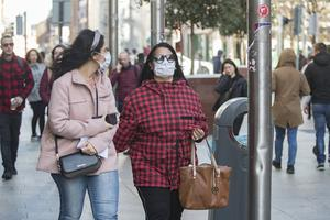 Shoppers wearing surgical face masks on Dublin's Henry Street. Picture: Arthur Carron