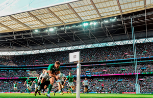 Tommy Bowe, Ireland, goes over to score his side's first try despite the tackle of Ionut Botezatu, Romania. 2015 Rugby World Cup, Pool D, Ireland v Romania, Wembley Stadium, Wembley, London, England. Picture credit: Stephen McCarthy / SPORTSFILE