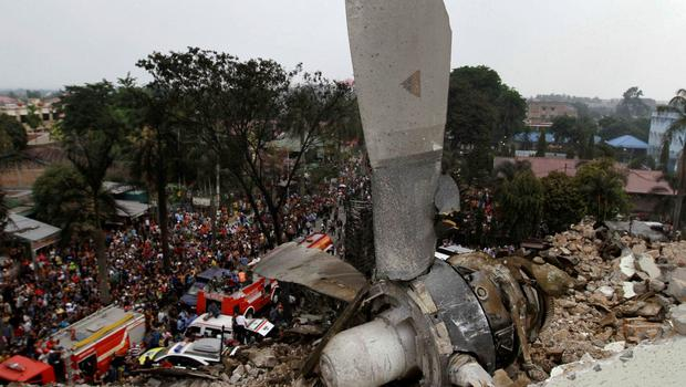 A propeller from an Indonesian military C-130 Hercules transport plane rests on the roof of a building after the plane crashed into a residential area in the North Sumatra city of Medan, Indonesia. Reuters/Roni Bintang