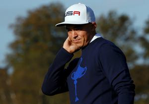U.S. Ryder Cup player Rickie Fowler reacts on the fifth fairway during his fourballs 40th Ryder Cup match at Gleneagles in Scotland September 26, 2014         REUTERS/Russell Cheyne (BRITAIN  - Tags: SPORT GOLF)