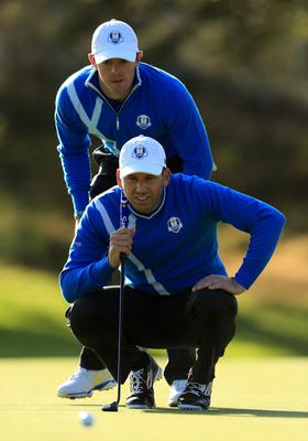 Europe's Sergio Garcia and Rory McIlroy (top) during the fourballs on day one of the 40th Ryder Cup at Gleneagles Golf Course, Perthshire. PRESS ASSOCIATION Photo. Picture date: Friday September 26, 2014. Photo credit should read: Lynne Cameron/PA Wire. RESTRICTIONS: Use subject to restrictions. Editorial use only. No commercial use. Call +44 (0)1158 447447 for further information.