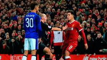 Tempers flare between Everton's Mason Holgate (left) and Liverpool's Roberto Firmino during their FA Cup third round clash at Anfield. Photo: PA