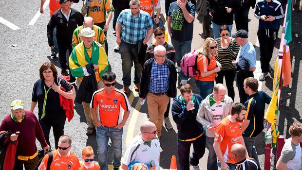 14 June 2015; Armagh and Donegal supporters make their way to the grounds ahead of the game. Ulster GAA Football Senior Championship Quarter-Final, Armagh v Donegal. Athletic Grounds, Armagh. Picture credit: Brendan Moran / SPORTSFILE