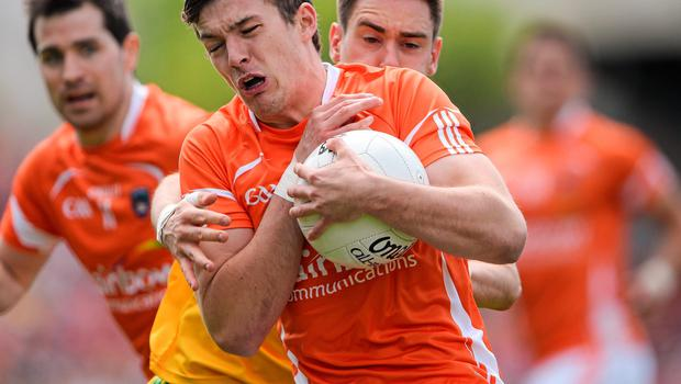 14 June 2015; Ethan Rafferty, Armagh, in action against Martin O'Reilly, Donegal. Ulster GAA Football Senior Championship Quarter-Final, Armagh v Donegal. Athletic Grounds, Armagh. Picture credit: Brendan Moran / SPORTSFILE