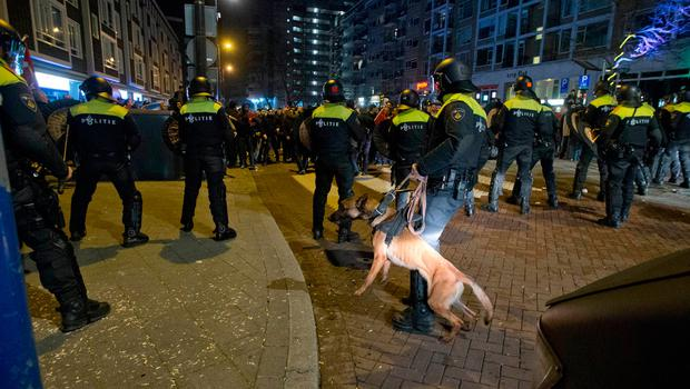 Dutch riot police charges after riots broke out at a pro Erdogan demonstration outside the Turkish consulate in Rotterdam, Netherlands (AP Photo/Peter Dejong)