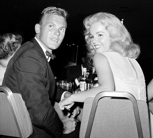 HOLLYWOOD ICON: Actor Tab Hunter with actress Tuesday Weld at a dinner reception in Los Angeles in 1959. Photo: AP