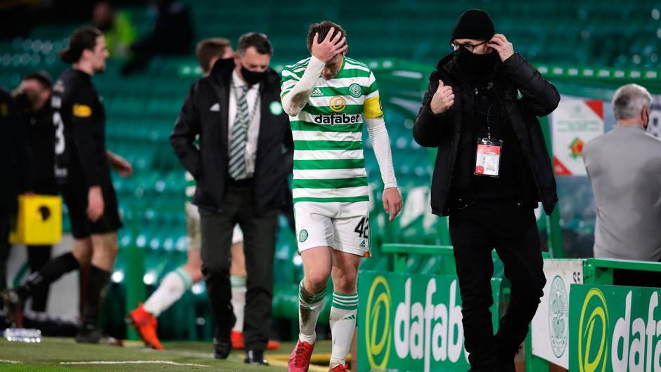 Celtic's Callum McGregor is dejected as he walks down the touchline to do a TV interview following the Scottish Premiership draw with Livingston at Celtic Park, Glasgow