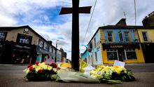 A cross and flowers form a shrine for Det Garda Colm Horkan at the spot where he was killed in the centre of Castlerea. Photo: Gerry Mooney