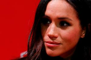 Meghan Markle gestures as they tour the Terrence Higgins Trust World AIDS Day charity fair at Nottingham Contemporary in Nottingham, central England, on December 1, 2017