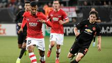 AZ Alkmaar's Owen Wijndal in action with Manchester United's Daniel James in action during the Europa League Group L clash at the Cars Jeans Stadion, The Hague, Netherlands