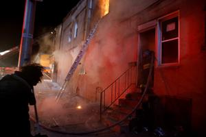 An explosion rocks a building and sends debris flying on Baltimore's East Biddle street as firefighters attack a fire set by rioters in a convenience store and residence during clashes in Baltimore, Maryland in the early morning hours of April 28, 2015. REUTERS/Jim Bourg
