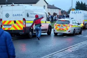 A rioter throws a brick at a garda car during a Anti Water charges demonstration in Jobstown yesterday. Photo: Tony Gavin 15/11/2014