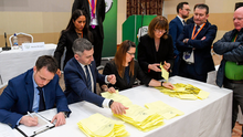 Officials from FIFA and UEFA (back left) observe the counting of votes during the presidential election at the FAI EGM at the Crowne Plaza Hotel in Blanchardstown, Dublin. Photo by Matt Browne/Sportsfile
