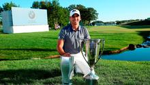 Day with his silverware after winning the BMW Championship at the Conway Farms Golf Club