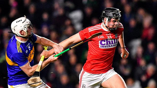 Darragh Fitzgibbon of Cork is tackled by Séamus Kennedy of Tipperary. Photo: Eóin Noonan/Sportsfile