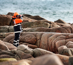 A member of the Civil Defence continues the search