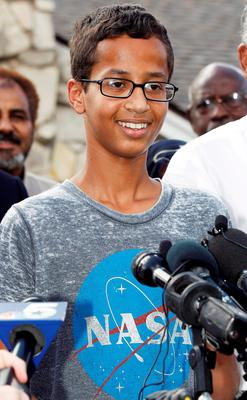Ahmed Mohamed, 14, thanks supporters during a news conference at his home, Wednesday, Sept. 16, 2015, in Irving, Texas. Mohamed was arrested after a teacher thought a homemade clock he built was a bomb. (AP Photo/Brandon Wade)