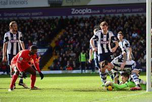 Kolo Toure of Liverpool reacts as goalkeeper Ben Foster of West Bromwich saves his shot