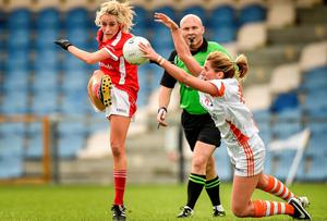 Cork's Orla Finn has her effort blocked by Sinead McCleary of Armagh during the All-Ireland ladies football semi-final at Pearse Park. Photo: Paul Mohan / SPORTSFILE