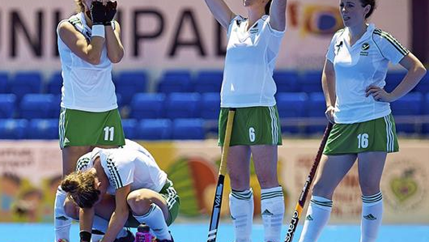 Ireland players, from left to right, Megan Frazer, Emma Smyth and Aine Connery following their side's defeat (David Aliaga / SPORTSFILE)