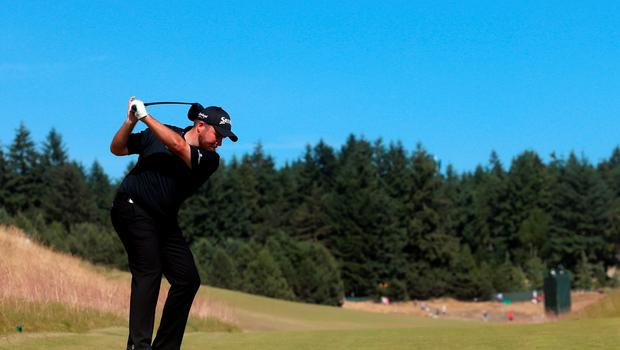 UNIVERSITY PLACE, WA - JUNE 20: Shane Lowry of Ireland hits his tee shot on the 13th hole during the third round of the 115th U.S. Open Championship at Chambers Bay on June 20, 2015 in University Place, Washington.  (Photo by Andrew Redington/Getty Images)