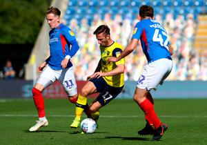 James Henry of Oxford United is challenged by Ronan Curtis of Portsmouth and Steve Seddon of Portsmouth during the Sky Bet League One play-off semi-final second leg