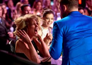 Singer/songwriter Taylor Swift (L) reacts to winning the Best Lyrics award for 'Blank Space' with singer Justin Timberlake in the audience during the 2015 iHeartRadio Music Awards