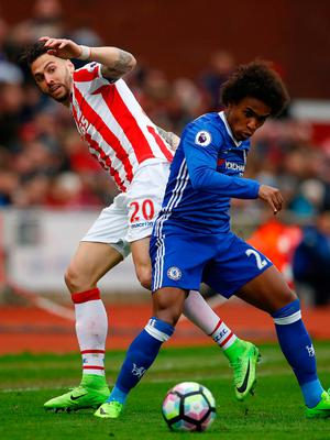 Chelsea's Willian in action with Stoke City's Geoff Cameron. Photo: Phil Noble/Reuters