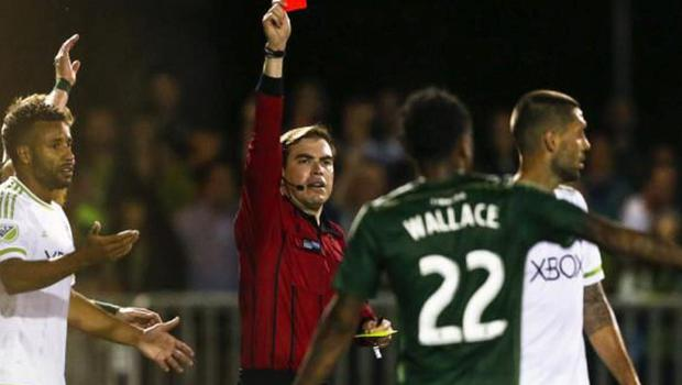 Clint Dempsey is shown a red card