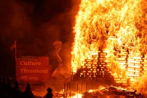 A bonfire is lit on Belfast's Lower Newtownards Road as bonfires were set to be lit at midnight, as part of a loyalist tradition to mark the anniversary of the Protestant King William's victory over the Catholic King James at the Battle of the Boyne in 1690. Photo credit: Niall Carson/PA Wire
