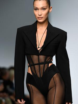 US model Bella Hadid presents a creation by Mugler during the Women's Spring-Summer 2020 Ready-to-Wear collection fashion show in Paris, on September 25, 2019. (Photo by Christophe ARCHAMBAULT / AFP)