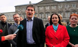 Decision to make: Green Party leader Eamon Ryan and deputy leader Catherine Martin with Green Party TDs during a press briefing at Leinster House. Photo: Gareth Chaney/Collins