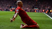 Liverpool's Martin Skrtel celebrates scoring against Arsenal during their English Premier League soccer match at Anfield
