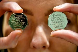 Punctuating the change: The new 50p celebrates Brexit, but will be remembered for sacrificing the Oxford comma and stirring an argument over punctuation. Photo: Ben Birchall/PA Wire