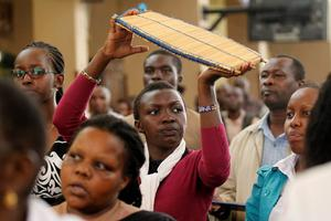 """A choir member plays the """"Kayamba"""" instrument during a special Easter mass at the Holy Family Basilica Catholic Church for the victims of the Garissa University attack in Kenya's capital Nairobi April 5, 2015."""