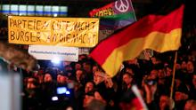 "Participants hold banners and German national flags during a demonstration called by anti-immigration group PEGIDA. The banner reads reads, ""Bye, bye political parties. Power to us citizens. Add a referendum to the constitution"" (REUTERS/Hannibal Hanschke)"