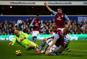 Ron Vlaar of Aston Villa slides in to tackle Bobby Zamora. Photo credit: Ian Walton/Getty Images