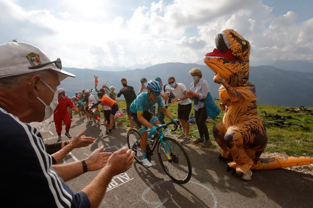 Colombia's Miguel Angel Lopez climbs the Loze pass to win the stage 17 of the Tour de France cycling race over 170 kilometers from Grenoble to Meribel Col de la Loze. (AP Photo/Christophe Ena)