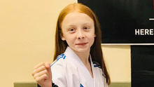 Lily Sheeran celebrates her victory in the Adidas Karate Open