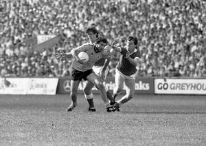 Dublin's Ciarán Duff pictured in possession during the All-Ireland Senior Football Championship semi-final replay at Páirc Uí Chaoimh, Cork on August 28, 1983. Pic: Liam Mulcahy (Part of the Independent Newspapers Ireland/NLI Collection)
