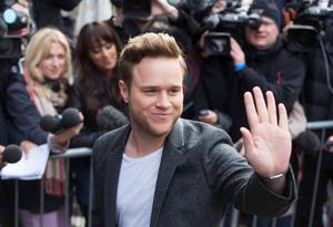 British singer Olly Murs arrives for the recording of the Band Aid 30 charity single in west London November 15, 2014. Singers came together to record a new version of the Band Aid charity song to raise money to combat Ebola in Africa.