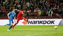 Carlos Bacca scores the third goal for Sevilla