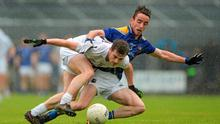 Kildare's Niall Kelly battles for the ball against Longford's Colm Smyth in Cusack Park last night.